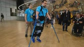 yardım : Moscow, Russia - April 24, 2018: Demonstration of powered exoskeleton for disabled persons at Skolkovo Robotics Forum
