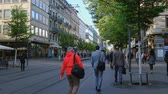 tram : Zurich, Switzerland - May 3, 2018: People and city transport at Bahnhofstrasse at the morning time Stock Footage