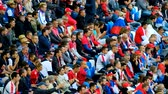 serbia : Kaliningrad - Russia, June 22, 2018: Football fans support teams on the match between Serbia and Switzerland