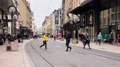 turyści : Geneve, Switzerland - May 3, 2018: People and city transport in old city centre at the day time