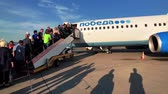 custo : Moscow, Russia - April 19, 2018: Passengers boarding on the aircraft of low cost airline company Pobeda