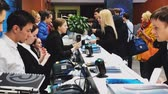 congresso : Moscow, Russia - March 27, 2018: Visitors of business conference check-in in registration deck