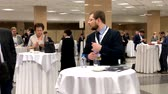 kahve molası : Moscow, Russia - March 27, 2018: Visitors of business conference having coffee break