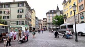 szwajcaria : Zurich, Switzerland - July 20, 2018: Tourists visit old city pedestrian street at summer day time