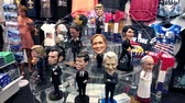 sklep : New York, USA - September 6, 2018: Funny presidential figures in a souvenir shop on Fifth Avenue