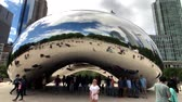 chicago : Chicago, USA - September 6, 2018: Tourists visiting the city landmark sculpture. Cloud Gate is a public sculpture by Indian-born British artist Sir Anish Kapoor