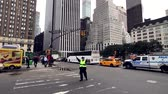 police officers : New York, USA - September 6, 2018: Policeman regulates traffic on the streets of Manhattan