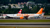 fácil : Zurich, Switzerland - July 19, 2018: EasyJet Airline Company airplane taxiing to the gate. EasyJet Airline Company Limited is a British low-cost carrier airline headquartered at London Luton Airport