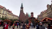 christmas market : Wroclaw - Poland, November 24, 2018: People attend christmas market in old city