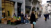 bazar : Lausanne, Switzerland - April 24, 2018: Street vendor sells fruits and vegetables Stock Footage