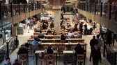 tavolo pranzo : Moscow, Russia - November 19, 2018: People eat in a food court in the Central Market
