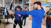 стрельба из лука : Moscow, Russia - April 24, 2018: Men shooting an archer indoors Стоковые видеозаписи