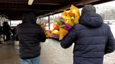 womens : Moscow, Russia - April 23, 2018: Men bought a lot of flowers as a gift for their women Stock Footage