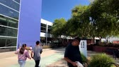 google campus : Mountain View, USA - September 25, 2018: Employees working outdoors at Googleplex headquarters main office Stock Footage
