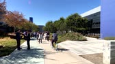 google campus : Mountain View, USA - September 25, 2018: Employees walking outdoors at Googleplex headquarters main office Stock Footage