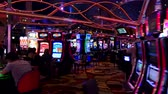 слот : Las Vegas, USA - September 10, 2018: People are playing slot machines at MGM casino