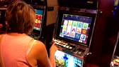 Las Vegas, USA - September 10, 2018: Woman playing slot machine in casino
