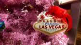 toys : Las Vegas, USA - September 10, 2018: Welcome to Las Vegas sign at the pink christmas tree Stock Footage