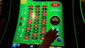 победитель : Las Vegas, USA - September 10, 2018: Roulette slot machines at MGM casino Стоковые видеозаписи