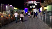 Las Vegas, USA - September 10, 2018: People attend Strip landmarks at night time Wideo