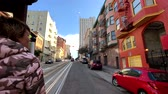 kablolar : San Francisco, USA - September 10, 2018: Cityscape at sunny day time, pov view from riding retro tram