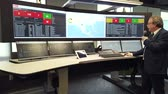 una persona : Kaliningrad, Russia - April 10, 2019: Engineering monitoring system with multiple screens demonstration