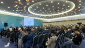 컨벤션 : Moscow, Russia - March 13, 2019: People attend business forum in large congress hall 무비클립