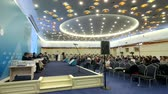 una persona : Moscow, Russia - March 13, 2019: People attend business forum in large congress hall Archivo de Video