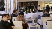 una persona : Kaliningrad, Russia - April 10, 2019: People visit the bar during a break in a business conference Archivo de Video