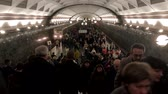 ingázó : Moscow - April 24, 2019: Crowd of commuters in the subway at morning