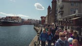 harbour : Gdansk, Poland - May 6, 2019: POV walking at old city harbour embankment Filmati Stock