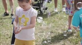 soap bubbles : Moscow - June 22, 2019: Children are having fun playing with soap bubbles