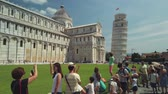 catholic church : Pisa, Italy - August 5, 2019: Tourists visiting the famous landmark leaning tower in the daytime