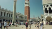 İtalya : Venice, Italy - August 4, 2019: Tourists sightseeing in Venices most famous square San Marco. Stok Video