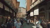 památka : Florence, Italy - August 1, 2019: Tourists walking on famous Firenze landmark Ponte Vecchio bridge
