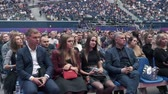 kongre : Saint Petersburg, Russia - October 4, 2019: Business conference attendees sit and listen to lecturer at large satdium