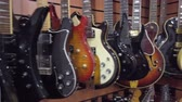 muzycy : Moscow - November 15, 2019: Different electric guitars hang in the music instruments store for sale
