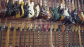 muzikanten : Moscow - November 15, 2019: Different electric guitars hang in the music instruments store for sale