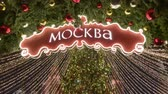 azevinho : Moscow, Russia - December 24, 2019: Tall illuminated tree at Christmas market, view from below, inscription translation is Moscow