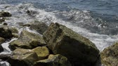край : Sea waves are crushing onto the rocky shore
