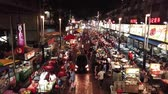 Aerial view in Malaysia, Kuala Lumpur of Jalan Alor with people, restaurants, cars and street markets at night