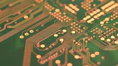 Circuit board with components in rotation. Close up of green printed electronic board, with components. 4K UHD Video