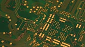 computer chip : Circuit board with components in rotation. Close up of green printed electronic board, with components. 4K UHD Video
