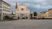 kısa : Florence, 4 March 2019: Basilica of Santa Maria Novella in the homonym square. Timelapse in Florence. Cloudy sky in march. Italy. Stok Video