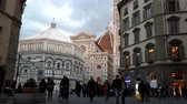 Florence, 4 March 2019: The Basilica of Santa Maria del Fiore with Battistero. Timelapse with people and traffic in the square of Cathedral. Florence, Italy.