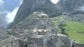 columbian : View of the ancient Inca City of Machu Picchu. The 15-th century Inca site.Lost city of the Incas. Ruins of the Machu Picchu sanctuary. UNESCO World Heritage site