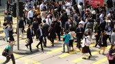 вид транспорта : Hong Kong, China- March 27, 2018: Crowded people are crossing the street in Central, Hong Kong.
