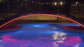 mávání : Pool with night lighting, which changes color. Outdoor pool with cold water. Night swimming pool with lighting. Changing colorful lights in the night pool. Dostupné videozáznamy