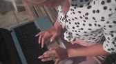 портативный : Female hands typing on the laptop, top view. Keyboard typing by hand. Office work. Businesswoman in a white shirt with black peas.