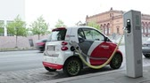 electro mobility : HAMBURG - MAY 30: Electro car is charging in the street on May